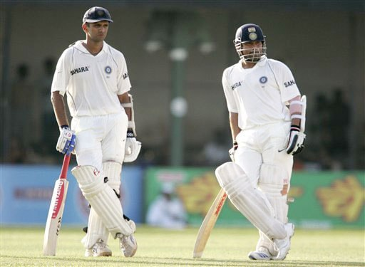 Rahul Dravid and Sachin Tendulkar wait for the third umpire's decision during the third day's play of the tfinal Test in Colombo on August 10, 2008.
