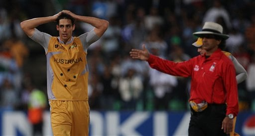 Australia's Mitchell, left reacts as umpire Asad Rauf signals for a boundary against India during their Twenty20 World Championship Cricket match in Durban, South Africa, Saturday, Sept. 22, 2007