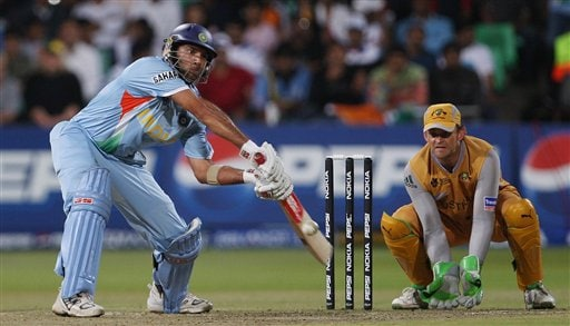 India's Yuvraj SIngh, left plays a shot as Australia's Adam Gilchrist looks on during their Twenty20 World Championship Cricket match in Durban, South Africa, Saturday, Sept. 22, 2007.