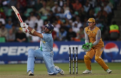 India's Yuvraj SIngh, left, plays a shot as Australia's Adam Gilchrist looks on during their Twenty20 World Championship Cricket match in Durban, South Africa, Saturday, Sept. 22, 2007.
