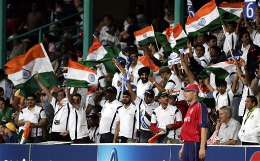 Indian cricket fans raise their national flags as England's Andrew Flintoff, wearing red t-shirt, stands before them during India and England's Twenty20 World Championship Cricket match in Durban, South Africa, Wednesday, Sept. 19, 2007.