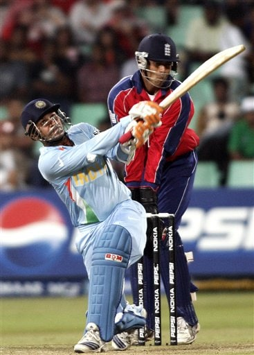 India's Virender Sehwag , left, plays a shot against England during their Twenty20 World Championship Cricket match in Durban, South Africa, Wednesday, Sept. 19, 2007.