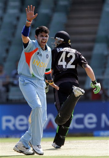 Sri Sreesanth, right, appeals unsuccessfully for a LBW against New Zealand's batsman Lou Vincent, unseen, as teammate Brendon McCullum, right, makes a run during their Super Eight's Twenty20 World Championship cricket match at the Wanderers Stadium in Johannesburg, South Africa, Sunday, Sept. 16, 2007.