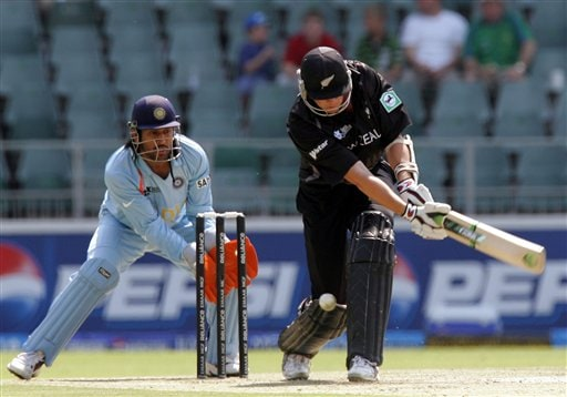 New Zealand's batsman Peter Fulton, misplays a delivery as India's wicketkeeper Mahendra Singh Dhoni, left, looks on during their Super Eight's Twenty20 World Championship cricket match against India at the Wanderers Stadium in Johannesburg, South Africa, Sunday, Sept. 16, 2007.