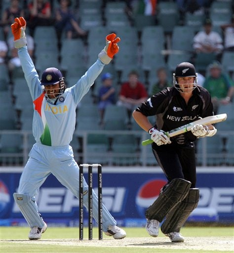 Mahendra Singh Dhoni, left, celebrates after a successfully appeal for LBW against New Zealand's batsman Peter Fulton, right, during their Super Eight's Twenty20 World Championship cricket match against New Zealand at the Wanderers Stadium in Johannesburg, South Africa, Sunday, Sept. 16, 2007.