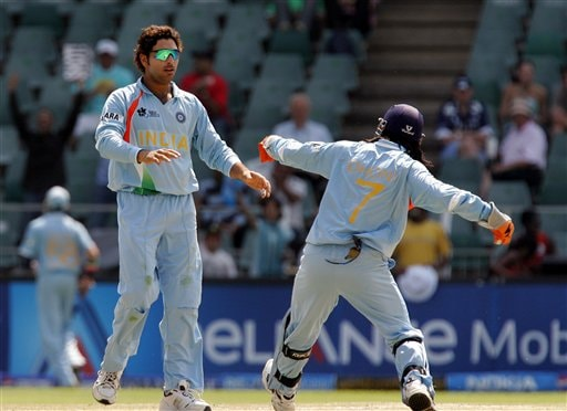 Yuvraj Singh, left, celebrates with his captain Mahendra Singh Dhoni, right, after dismissing New Zealand's batsman Ross Taylor, not pictured, for 11 runs during their Super Eight's Twenty20 World Championship cricket match against New Zealand at the Wanderers Stadium in Johannesburg, South Africa, Sunday, Sept. 16, 2007.