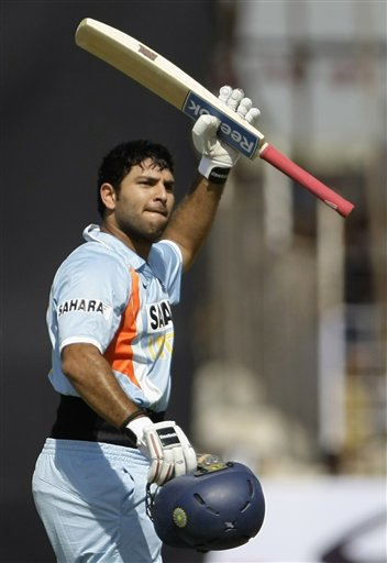 Indian batsman Yuvraj Singh reacts after scoring a century during the first ODI match between India and England in Rajkot on Friday. (AP Photo)