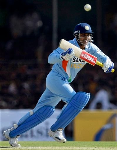 Indian batsman Virender Sehwag takes a single after playing a shot during the first ODI match between India and England in Rajkot on Friday. (AP Photo)