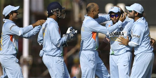 Indian cricketers congratulate team-mate Rohit Sharma after he dismissed England captain Kevin Pietersen during the first ODI match between India and England in Rajkot on Friday. (AP Photo)