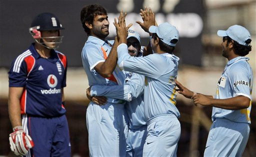 Indian cricketers congratulate team-mate Munaf Patel for dismissing England batsman Matthew Prior during their first ODI match in Rajkot on Friday. (AP Photo)