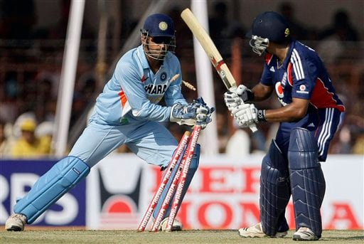 England's Samit Patel looks on as Indian captain MS Dhoni stumps him during their first ODI match in Rajkot on Friday. (AP Photo)