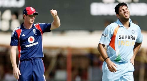 England's Paul Collingwood looks on as Indian batsman Yuvraj Singh winces in pain following an injury during the first ODI between India and England in Rajkot on Friday. (AFP Photo)