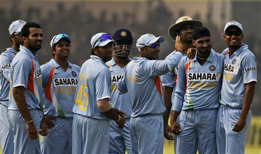 Indian players celebrate after bowler Harbhajan Singh dismiss England batsman Owais Shah during the third ODI between India and England in Kanpur on Thursday. (AP Photo)
