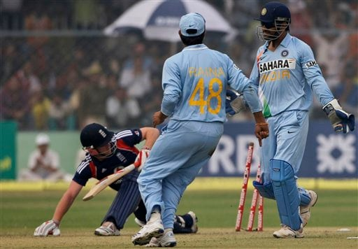 Indian captain MS Dhoni and Suresh Raina look on after stumping England batsman Paul Collingwood during the third ODI between India and England in Kanpur on Thursday. (AP Photo)