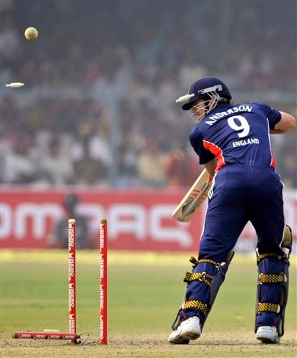 England's batsman James Anderson looks back to see himself clean-bowled during the third ODI between India and England in Kanpur on Thursday. (AP Photo)