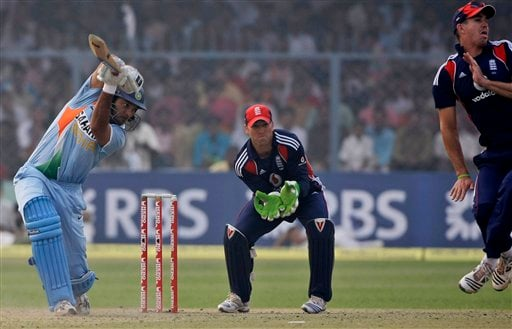 Indian batsman Yuvraj Singh plays a shot as England captain Kevin Pietersen takes evasive action and Matthew Prior looks on during the third ODI between India and England in Kanpur on Thursday. (AP Photo)