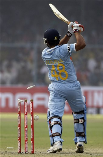 Indian batsman Suresh Raina is clean-bowled during the third ODI between India and England in Kanpur on Thursday.(AP Photo)