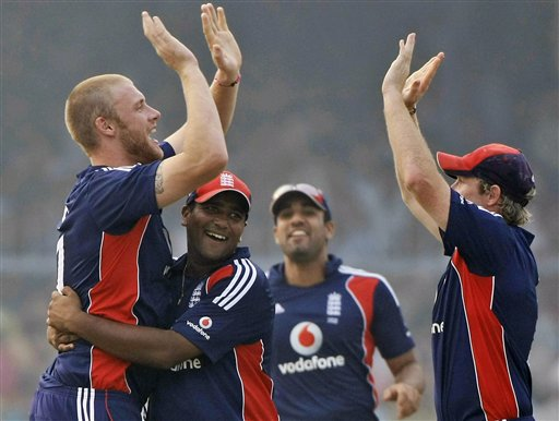 England's Samit Patel, Ravi Bopara and Ian Bell congratulate bowler Andrew Flintoff after he dismissed India batsman Virender Sehwag during the third ODI between India and England in Kanpur on Thursday.(AP Photo)