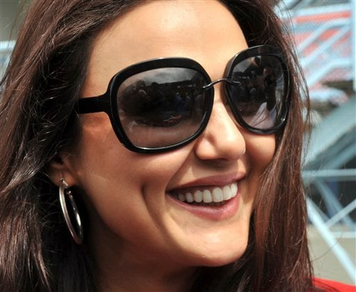 Bollywood star Preity Zinta waits to watch the 1st one-day international match between New Zealand and India at McLean Park in Napier on Tuesday, March 3, 2009. (AP Photo)
