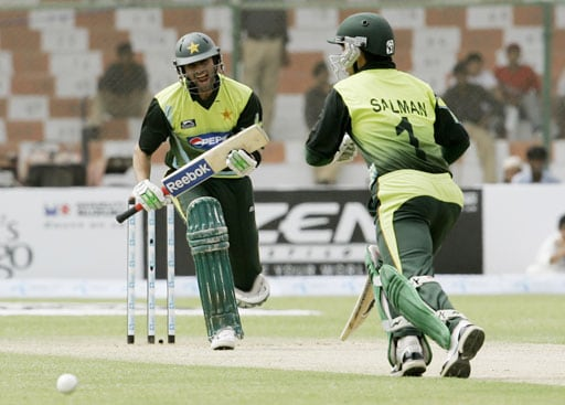 Shoaib Malik and Salman Butt struggle for a run against India during their Asia Cup match at National Stadium in Karachi, Pakistan on June 26, 2008.