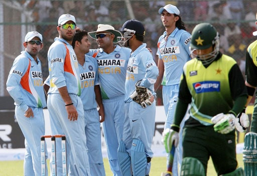 Piyush Chawla celebrates with teammates after taking the wicket of Salman Butt during their Asia Cup match at National Stadium in Karachi, Pakistan on June 26, 2008.
