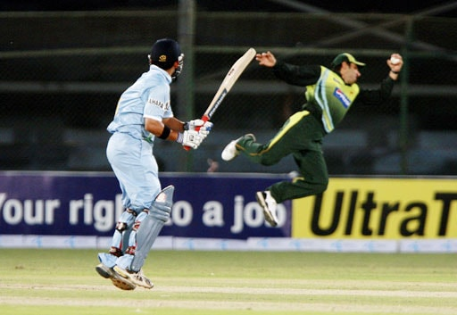 Gautam Ghambhir watches being caught out by Pakistani fielder Misbah-ul-Haq during the first round match against Inida for the Asia Cup Cricket Championship at National Stadium in Karachi, Pakistan on June 26, 2008.
