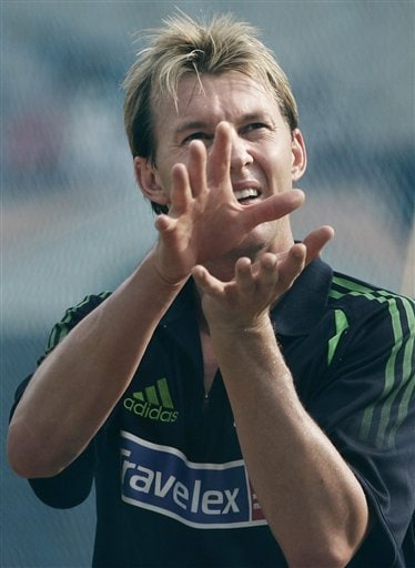 Australia's Brett Lee prepares to take a catch during a practice session, a day before the first one day international cricket match against India in Bangalore, India Friday, Sept. 28, 2007.