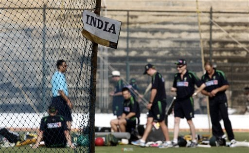 Australian cricket players practice next to the Indian practicing nets, a day before the first one day international cricket match between India and Australia in Bangalore, India Friday, Sept. 28, 2007.