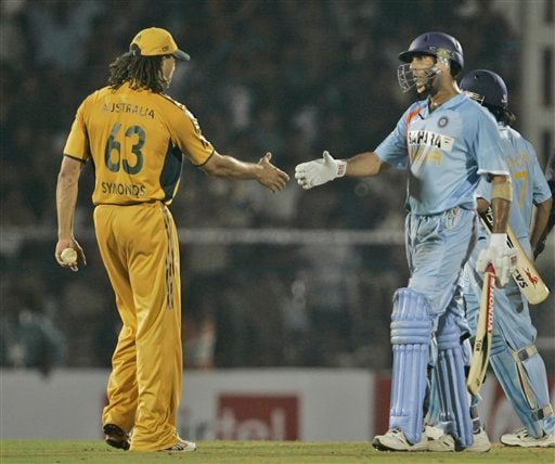 Indian cricketer Yuvraj Singh, right, shakes hands with Australia's Andrew Symonds after India defeated Australia by seven wickets in the Twenty20 match in Mumbai, India, Saturday, Oct. 20, 2007.