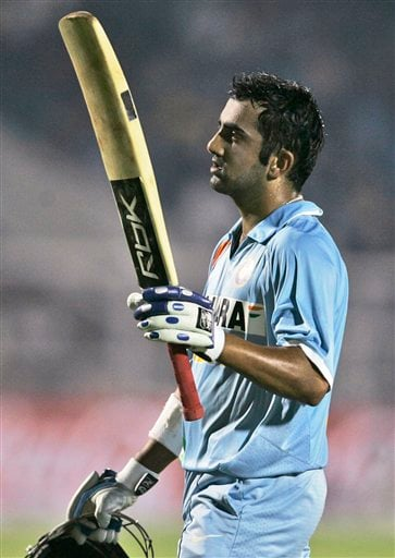India's Gautam Gambhir acknowledges the crowd's applause as he returns after losing his wicket during their Twenty20 match against Australia in Mumbai, India, Saturday, Oct. 20, 2007.