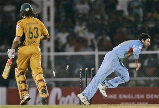 Indian cricketer Yuvraj Singh, right, successfully dismisses Australia's Andrew Symonds with a run-out during the Twenty20 match in Mumbai, India, Saturday, Oct. 20, 2007.