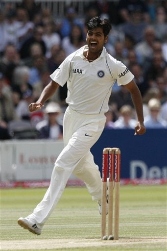 India's RP Singh celebrates after he claims the wicket of England's Paul Collingwood during the fourth day of the first Test Match at Lord's cricket ground, London on Sunday.