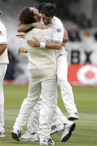 England's James Anderson, right, is congratulated by Ryan Sidebottom after he claims the wicket of India's Dinesh Karthik during the fifth day of the first Test at Lord's cricket ground, London on Monday.