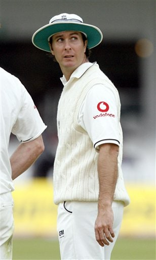 England's Michael Vaughan looks behind him as he leaves the pitch because of bad light with one Indian wicket standing, during the fifth day of the first Test Match against India at Lord's cricket ground, London on Monday.