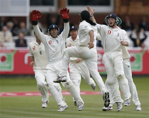 England's Monty Panesar,centre, celebrates with Matt Prior, left, and Ian Bell , right, after claiming the wicket of India's RP Singh during the fifth day of the first Test Matchat Lord's cricket ground, London on Monday.