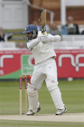 India's Dinesh Karthik hits a ball from England's Ryan Sidebottom during the fifth day of the first Test at Lord's cricket ground, London on Monday.