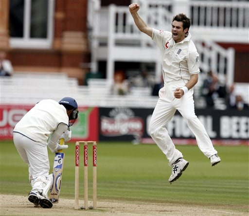India's Dinesh Karthik, left, holds his stroke as England's James Anderson claims his wicket during the fifth day of the first Test at Lord's cricket ground, London on Monday.