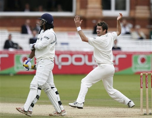 India's Mahendra Dhoni, left, holds his arm as England's James Anderson appeals for his wicket during the fifth day of the first Test at Lord's cricket ground, London on Monday.