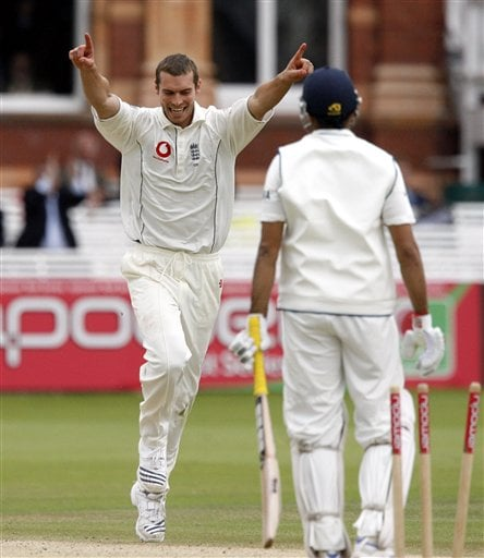 India's VVS Laxman, right, is bowled out by England's Chris Tremlett during the fifth day of the first Test Match at Lord's cricket ground, London on Monday.
