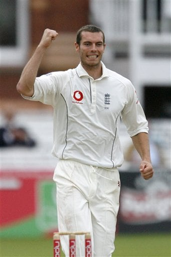 England's Chris Tremlett claims the wicket of India's Zaheer Khan during the fifth day of the first Test Match at Lord's cricket ground, London on Monday.