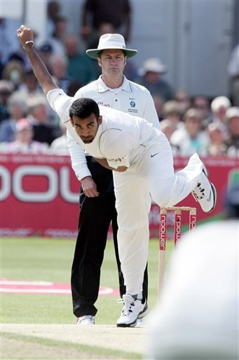 India's Zaheer Khan bowls a ball to England's Alastair Cook during the fourth day of the second Test cricket match at the Trent Bridge ground Nottingham on Monday.