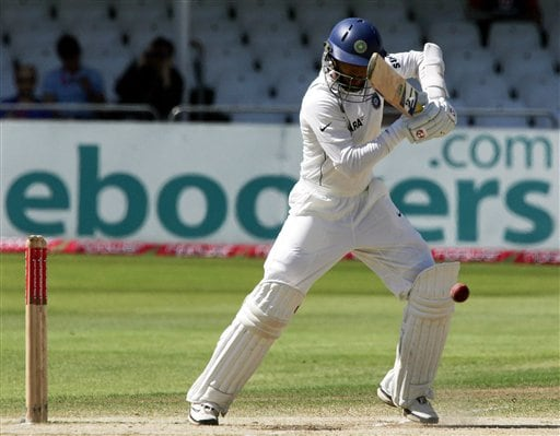 India's Dinesh Karthik hits a ball from England's Chris Tremlett during the fifth day of the second Test cricket match at the Trent Bridge ground Nottingham on Tuesday.