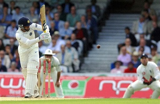 India's Dinesh Karthik hits off the bowling of England's Ryan Sidebottom during the first day of the Third Test Match at The Oval in London on Thursday.