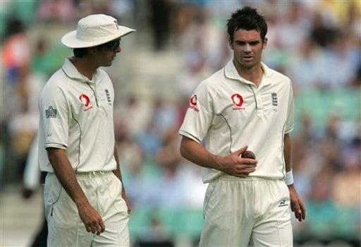 England's captain Michael Vaughn, left, talks to his bowler James Anderson on the first day of the third cricket test against India during at the Oval cricket ground in London on Thursday.