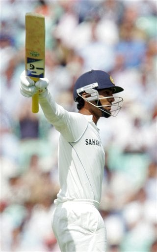 India's Dinesh Karthik celebrates getting 50 runs against England during the first days play at the third cricket test at the Oval in London on Thursday.