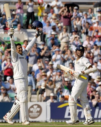India's Anil Kumble, left, celebrates scoring his maiden century against England with his batting partner Shanthakumaran Sreesanth on the second day of the third cricket test match against England at The Oval, London on Friday.