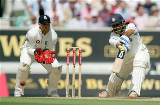India's Mahendra Dhoni drives the ball as keeper Matthew Prior looks on, left, on the second day of the third cricket test at the Oval cricket ground in London on Friday.