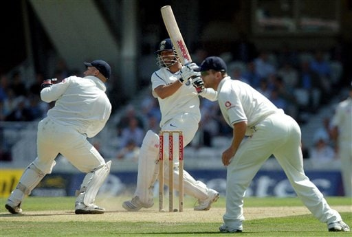 India's Sachin Tendulkar, center, hooks the ball for 4 runs as England's Matt Prior, left, and Paul Collingwood look on during the second day of the third cricket test match at The Oval, in London on Friday.