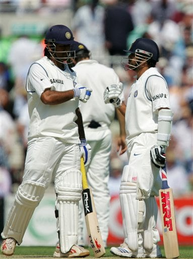 India's Sachin Tendulkar, right, gestures to teammate Mahendra Dhoni on the second day of the third cricket test against England at the Oval cricket ground in London on Friday.