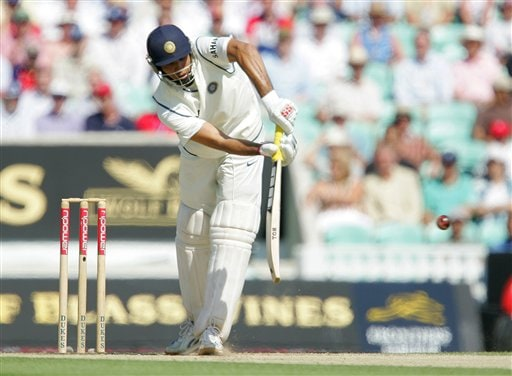 India's VVS Laxman hits four runs off England's James Anderson on the second da\ys play of the third cricket test at the Oval in London on Friday.